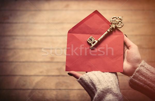 hands holding envelope and key Stock photo © Massonforstock
