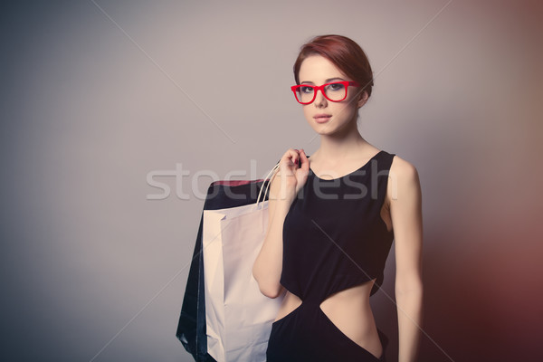 beautiful young woman with shopping bags on the wonderful grey b Stock photo © Massonforstock
