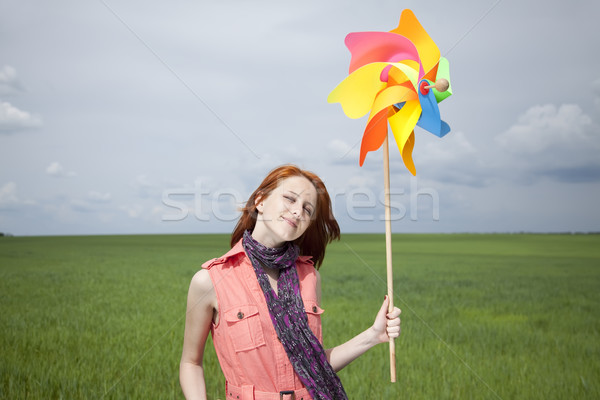 Beautiful girl with toy wind turbine at spring green wheat field Stock photo © Massonforstock