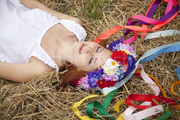 Slav girl with wreath lying at field Stock photo © Massonforstock