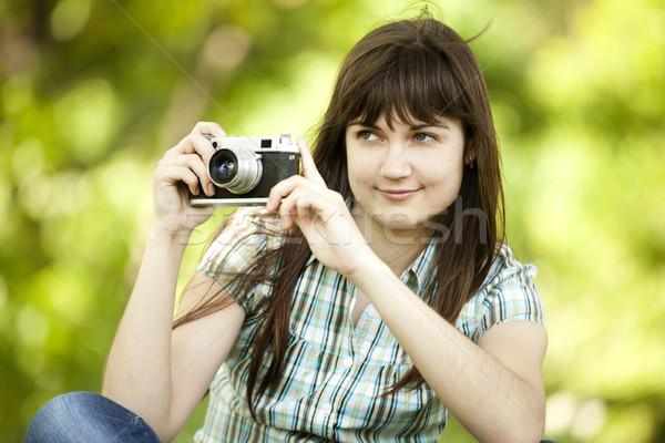 подростка девушка камеры зеленый парка трава женщины Сток-фото © Massonforstock