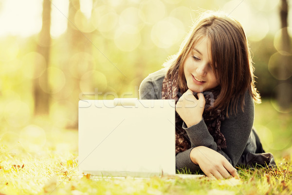 Beauty girl with laptop outdoors Stock photo © Massonforstock