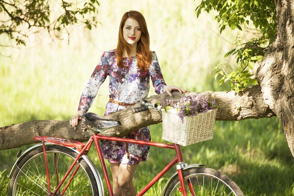 Girl on a bike in the countryside Stock photo © Massonforstock