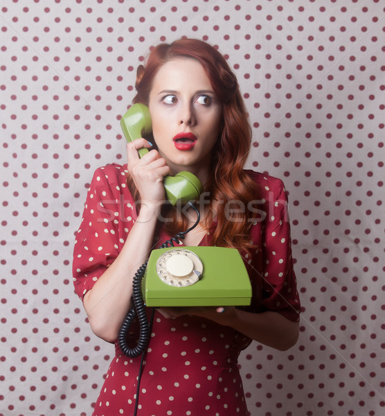 Portrait of a redhead girl with green dial phone Stock photo © Massonforstock