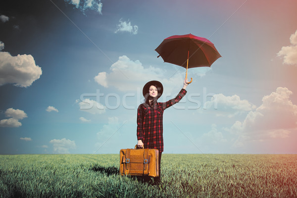 beautiful young woman with brown suitcase and umbrella standing  Stock photo © Massonforstock