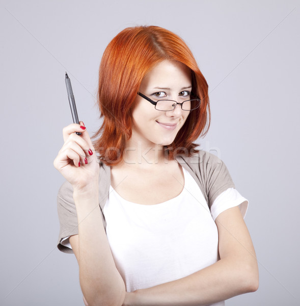 Young businesswomen with pen in hand Stock photo © Massonforstock