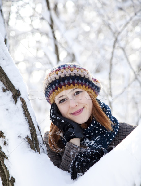 Beautiful young red-haired woman in winter park Stock photo © Massonforstock