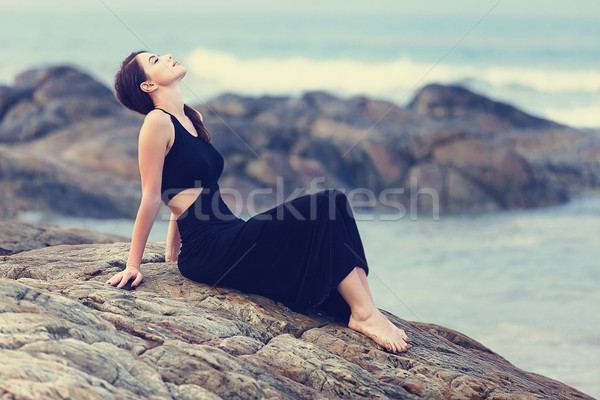 Portriat of Young redhead woman in a black dress Stock photo © Massonforstock