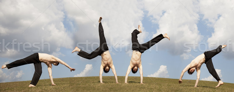 Hommes acrobatique prairie ciel printemps Photo stock © Massonforstock