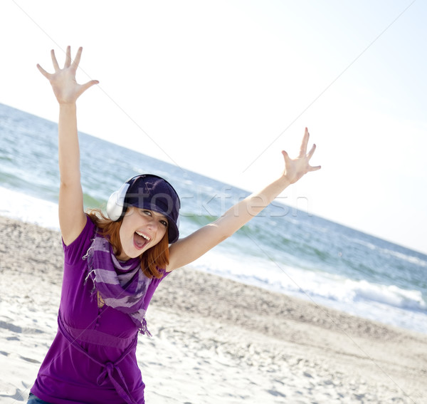 Portré lány fejhallgató tengerpart sapka nő Stock fotó © Massonforstock