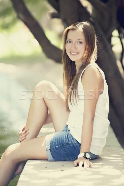 Teen girl near lake in the park. Stock photo © Massonforstock