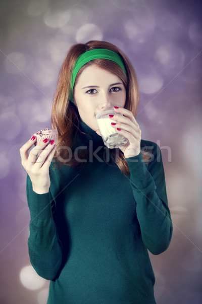 American redhead girl with milk and cake. Photo in 60s style. Stock photo © Massonforstock