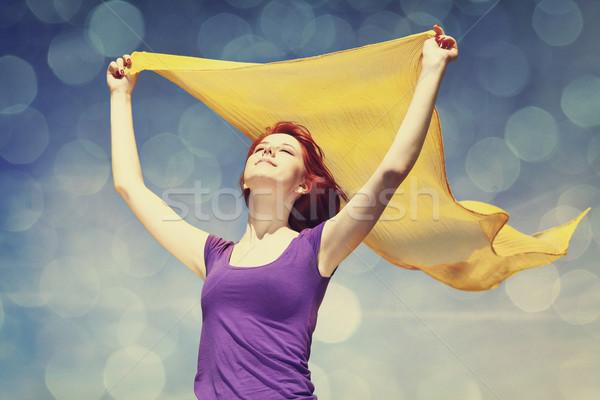 Genç kadın açmak silah sarı ipek rüzgâr Stok fotoğraf © Massonforstock