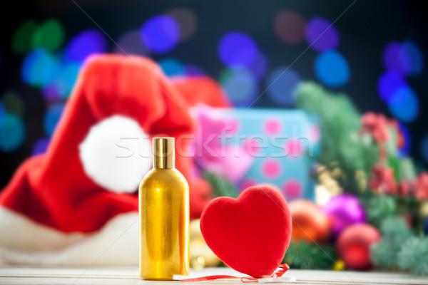 Forma de corazón juguete perfume botella Navidad luces Foto stock © Massonforstock