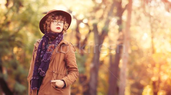 Girl in glasses and hat Stock photo © Massonforstock