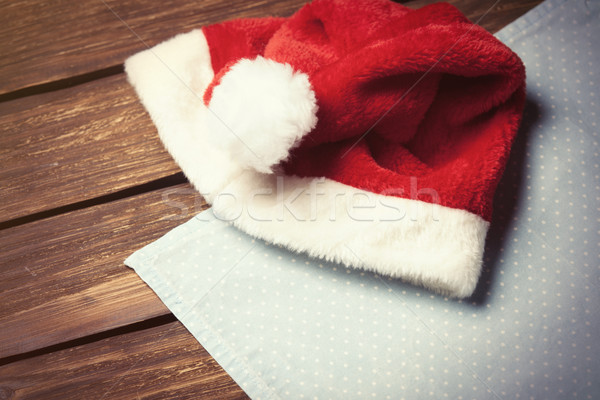 Red Santas hat and serviette  Stock photo © Massonforstock