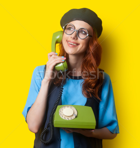 Happy redhead girl with dial phone  Stock photo © Massonforstock