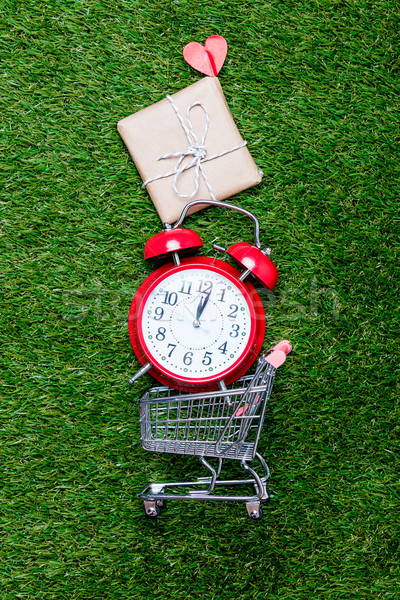 Self-service supermarket shopping trolley cart with gift box and Stock photo © Massonforstock