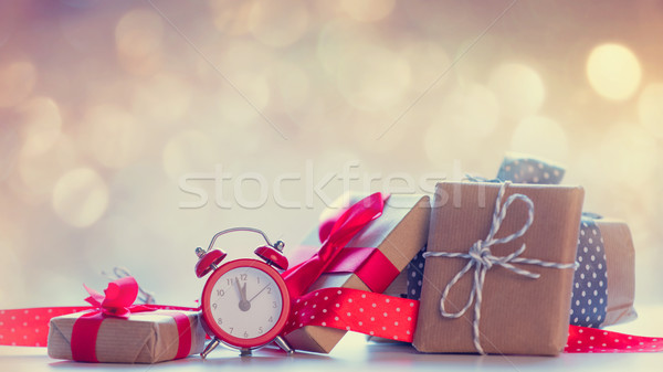 small alarm clock, red ribbon and beautiful gifts on the fairy l Stock photo © Massonforstock