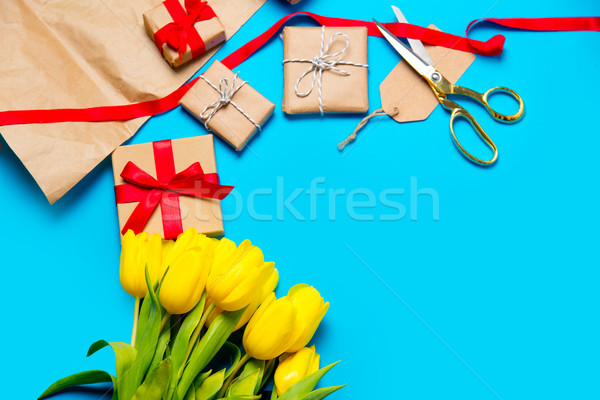 cute yellow tulips, beautiful gifts and cool things for wrapping Stock photo © Massonforstock
