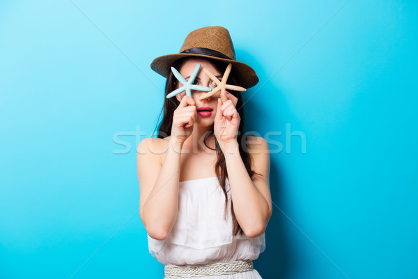 beautiful surprised young woman with starfishes standing in fron Stock photo © Massonforstock