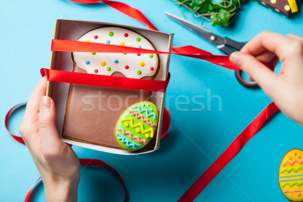 white caucasian female hands wrapping easter cake near things fo Stock photo © Massonforstock