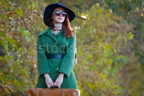 beautiful young woman standing on the wonderful trees background Stock photo © Massonforstock