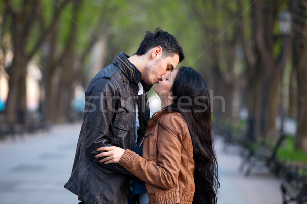 photo of cute couple kissing and hugging on the wonderful park b Stock photo © Massonforstock
