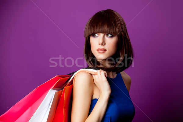 photo of beautiful young woman with colorful shopping bags on th Stock photo © Massonforstock