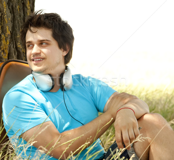 Stock photo: Men with headphones at countryside.