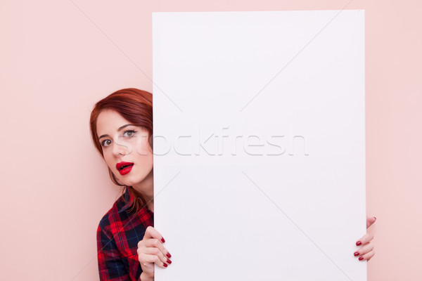 Young woman with white board  Stock photo © Massonforstock