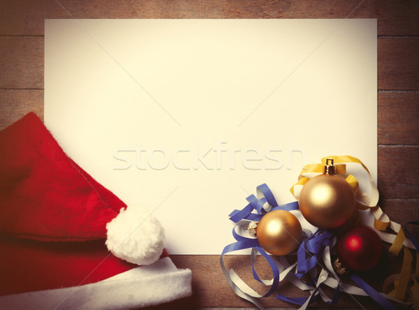 White papaer and christmas toys with Santas hat Stock photo © Massonforstock
