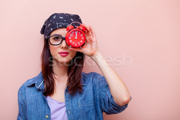 portrait of a young woman with alarm clock Stock photo © Massonforstock