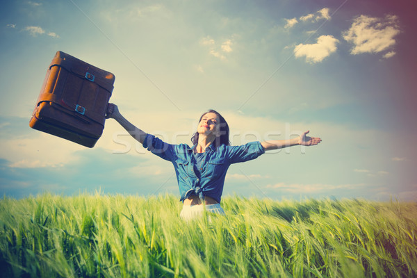 beautiful young woman with brown suitcase standing in the middle Stock photo © Massonforstock