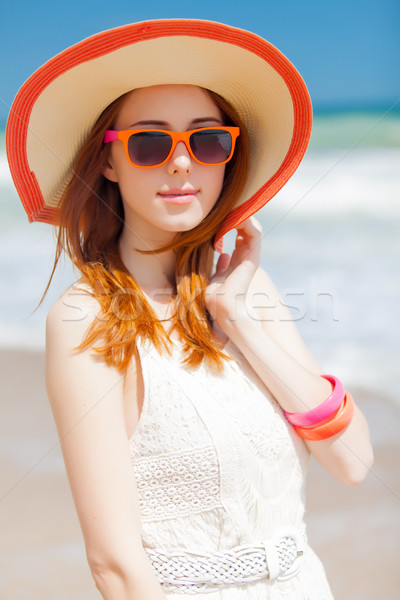 photo of beautiful young woman standing on the wonderful sea bac Stock photo © Massonforstock