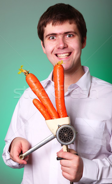Men with chopper and carrot  Stock photo © Massonforstock