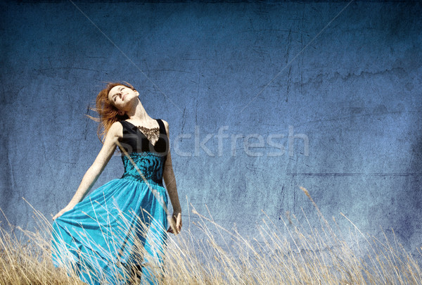 Redhead girl at windy field. Stock photo © Massonforstock