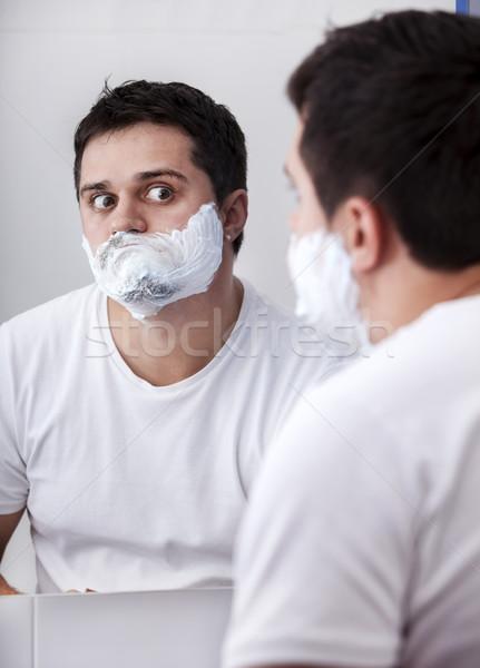 Surprised real men shaving. Stock photo © Massonforstock