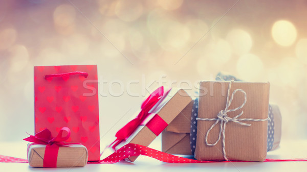 cool shopping bag, red ribbon and beautiful gifts on the fairy l Stock photo © Massonforstock