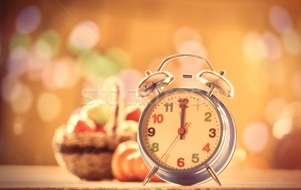 Alalrm clock and pumpkin Stock photo © Massonforstock