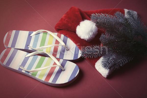 Flip flops and Santas hat  Stock photo © Massonforstock