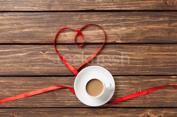 Cup of coffee and bow i Stock photo © Massonforstock