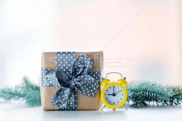 Christmas gift box and little alarm clock Stock photo © Massonforstock