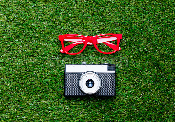 Vintage camera and red styled glasses Stock photo © Massonforstock
