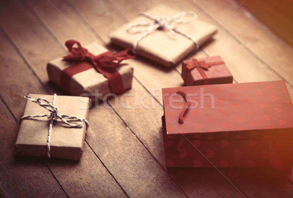 cute gifts and cool red shopping bag on the wonderful brown wood Stock photo © Massonforstock