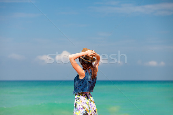 photo of beautiful young woman standing in front of wonderful se Stock photo © Massonforstock