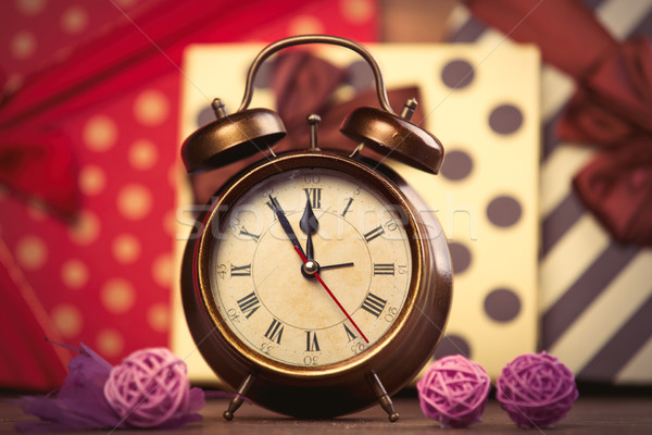 photo of alarm clock and balls on the wonderful gifts background Stock photo © Massonforstock