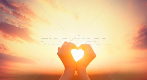 photo of beautiful female hands on the wonderful sunset backgrou Stock photo © Massonforstock