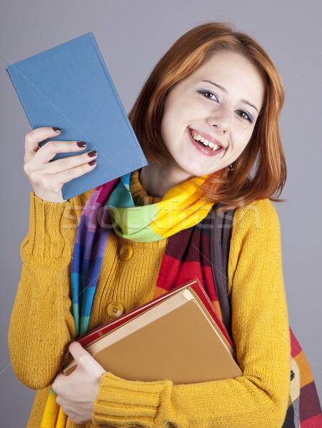 Stock fotó: Fiatal · diák · lány · könyvek · stúdiófelvétel · divat