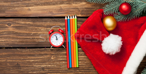 Alalrm-clock and gifts with pencils  Stock photo © Massonforstock